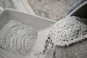 Cement in wheelbarrow at construction site.